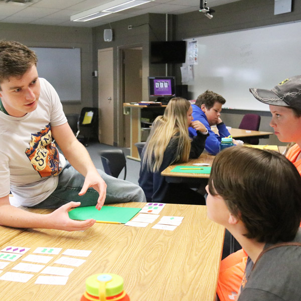 Instructor and students covering a concept during summer Math Jam camp