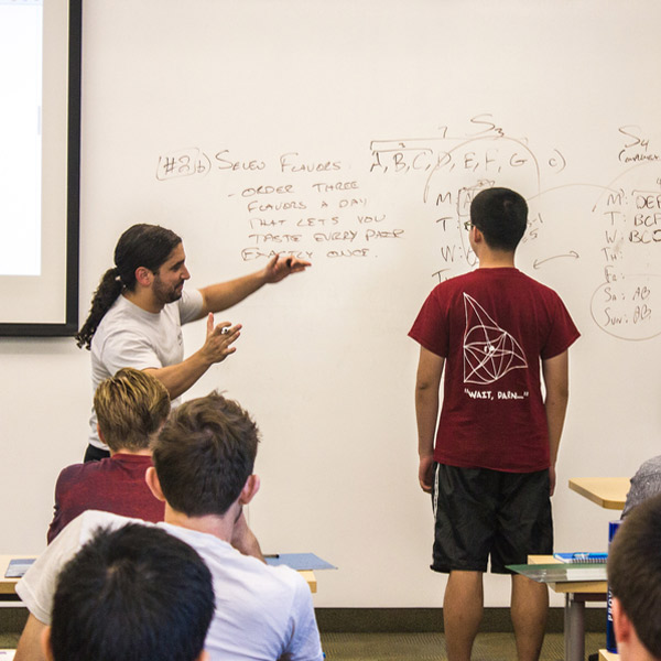Instructor and student with white board
