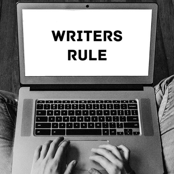 "Laptop with ""Writers Rule"" on the screen"