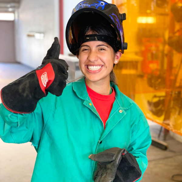 Student in welding gear at Women in Construction Management Summer Institute.