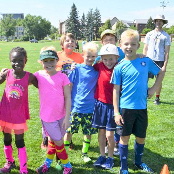 Youths and instruction at summer Youth Sport Camp